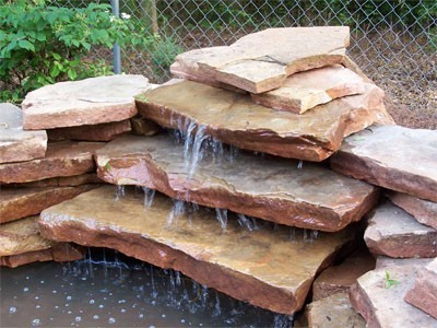 How to build a waterfall for your garden pond for Build a simple backyard waterfall